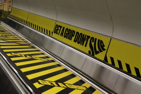'Get a grip, don't slip' campaign signage covers the Parliament station escalators