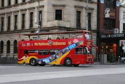 City Sightseeing Melbourne bus turns from Exhibition into Bourke Street