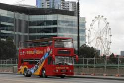 City Sightseeing Melbourne bus heads east over the La Trobe Street bridge