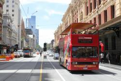 City Sightseeing Melbourne bus 9353AO heads west at Flinders and Elizabeth Street