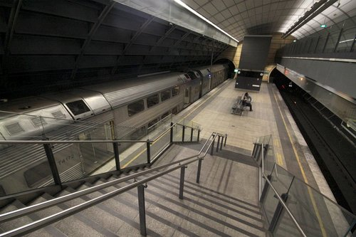 Up train picks up passengers at North Ryde station