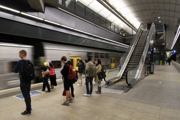 Passengers wait for an up train at Macquarie University station