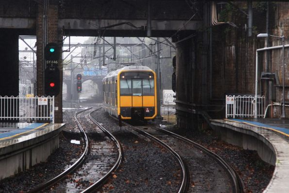 Tangara T46 on a down empty cars run holds short of the platform at Redfern