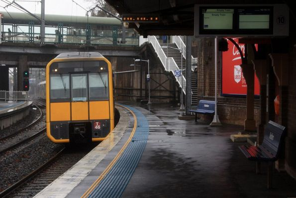 Tangara T46 passes through Redfern platform 10 empty cars