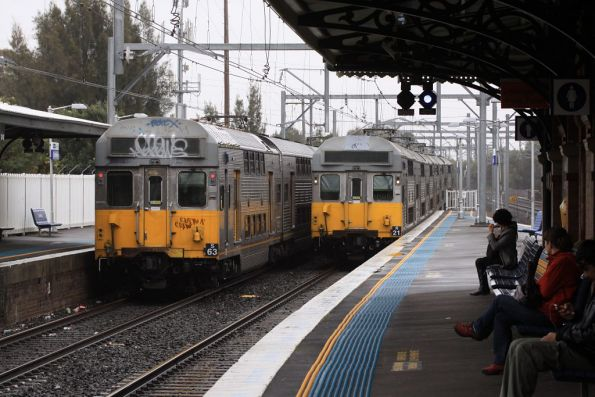 Sets S63 and R21 cross paths at Canterbury station