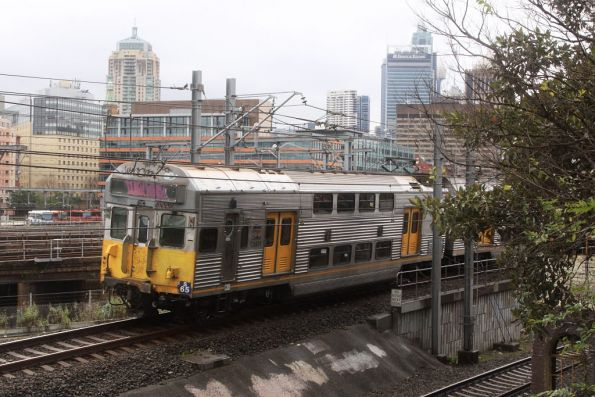 Set S65 heads towards Central, off the Airport Line