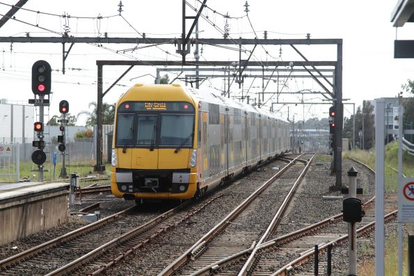 Waratah set A4 departs Campbelltown on the up