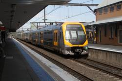 Millennium train set M9 and classmate arrives into Campbelltown station on the up