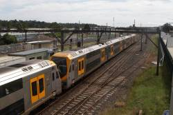 Millennium set M9 and classmate depart Campbelltown station on the up