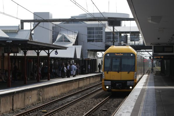 Waratah set A60 arrives into Campbelltown station with a service bound for Macarthur