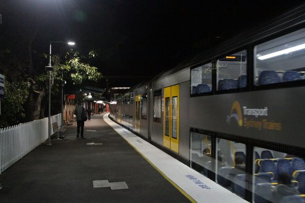 Waratah train departs Marrickville on the down