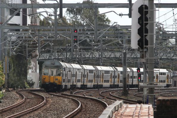 K63 approaches Burwood station with an up service