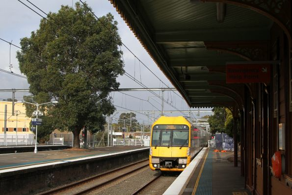 A55 leads a down Penrith service express through Homebush station