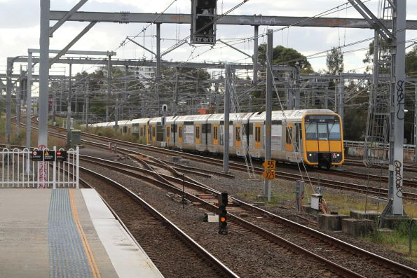 T32 leads an up service into Strathfield station