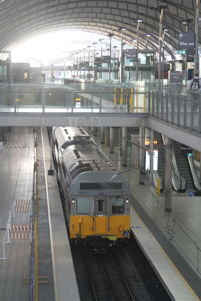 S53 departs Olympic Park station for Lidcombe