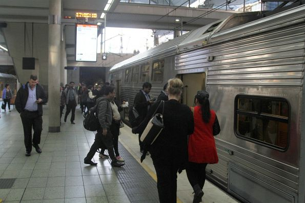 Passengers board the 'Olympic Park Sprint' train bound for Lidcombe
