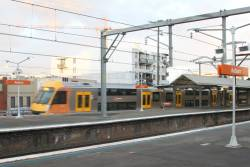 Waratah train passes through Auburn station with an up service