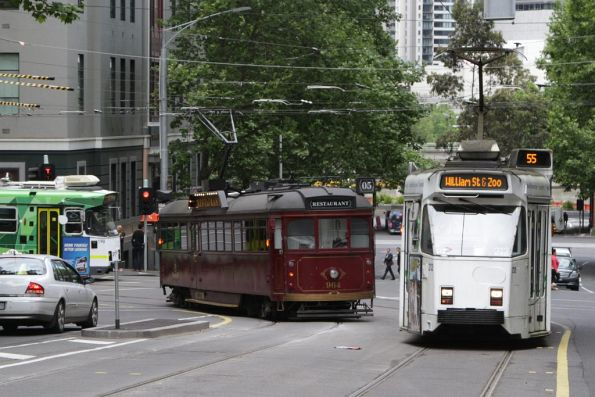 SW6.964 turned from William Street into Flinders Lane, passing a pair of northbound Z3 class trams on route 55