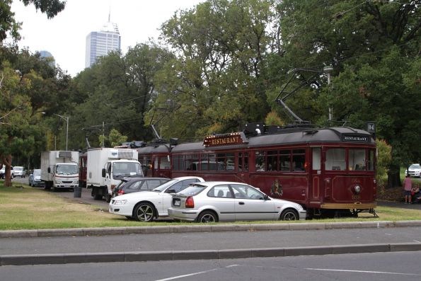 Trio of restaurant trams are loaded with food at the Dudley Street siding