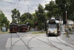 Z3.117 heads south on Peel Street with a route 55 service, as restaurant tram SW6.935 waits to leave the Dudley Street siding