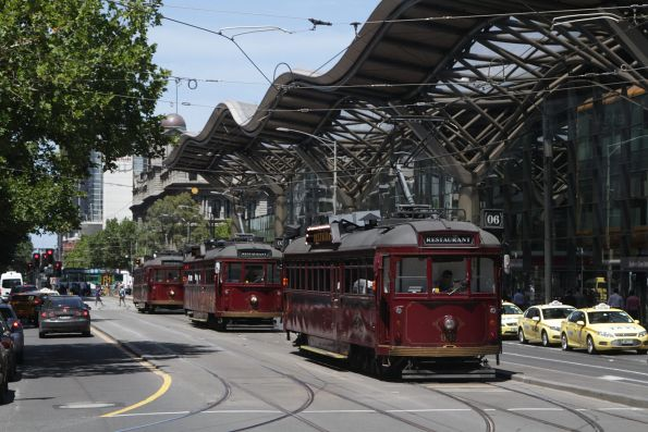 Trio of restaurant trams led by SW6.935 head north up Spencer Street