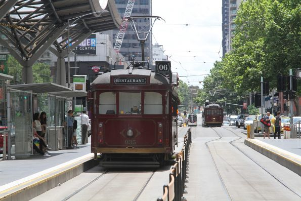 Restaurant tram SW6.935 approaches SW6.964 at the corner of Spencer and Little Collins Street