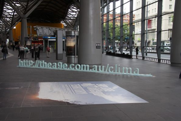 Broken 'The Age' advertising sign at the Spencer Street entrance to Southern Cross Station