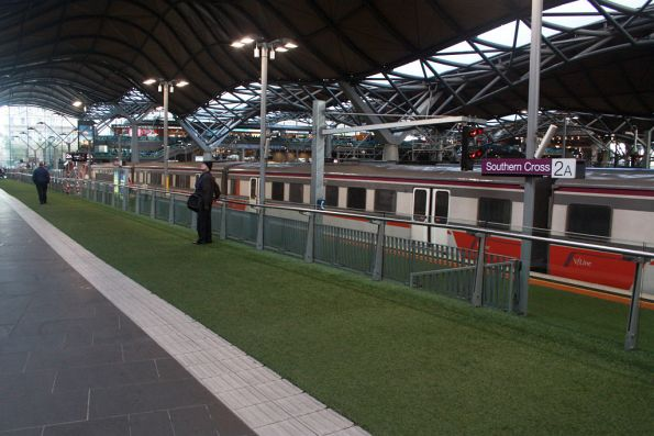Artificial grass laid on platform 2 for a Dairy Farmers promotion