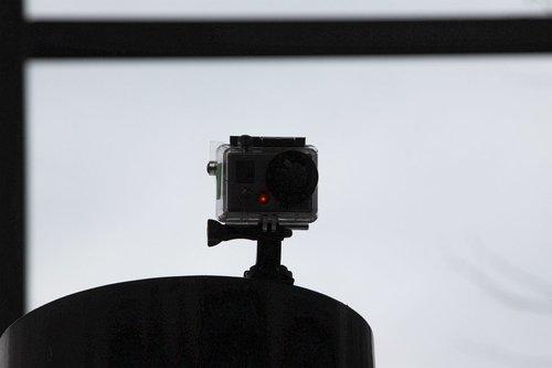 GoPro camera stuck atop a post