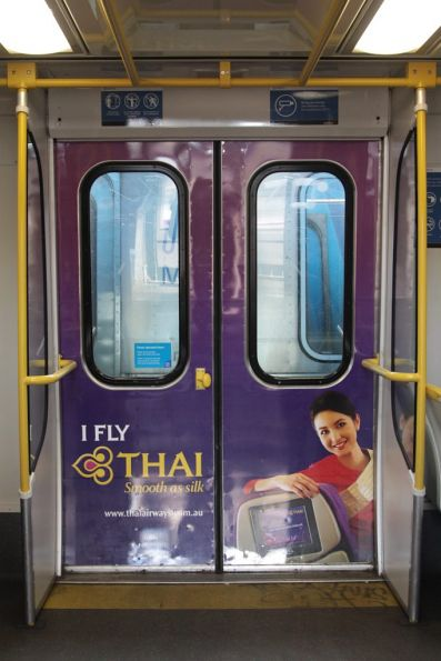 Thai Airways advertising inside the doors of a Comeng train