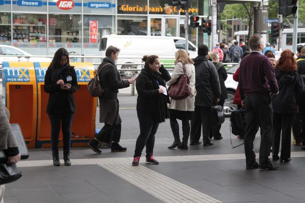 Fundraisers for 'Care Australia' at the main entrance to Southern Cross Station