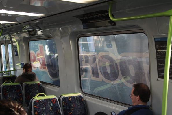 Trying to look out the windows of the train covered in Sportingbet advertising