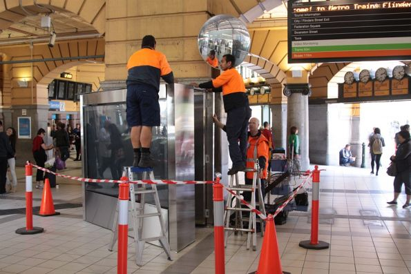 Reinstalling the JCDecaux advertising board beside the main dome at Flinders Street Station