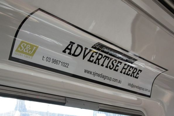 Advertising panels inside a Comeng train by S&J Media Group - '$4 per panel per day'