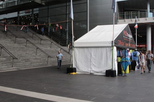 Grand Prix merchandise stall blocking the Bourke Street entrance to Southern Cross