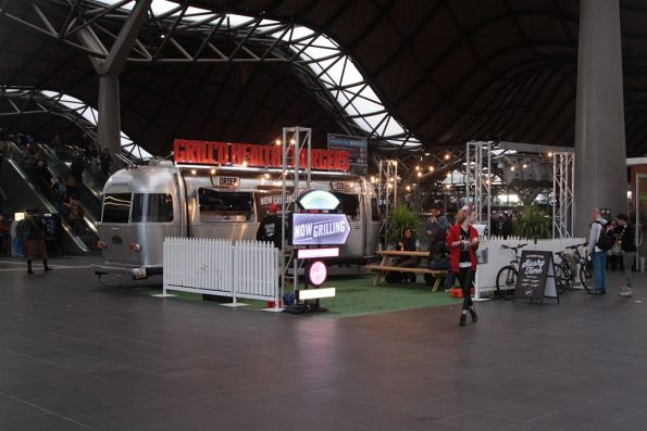 Caravan for fast foot joint 'Grill'd' in the station forecourt