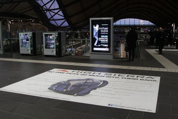 Advertising posters, signs and vending machines on the Collins Street concourse