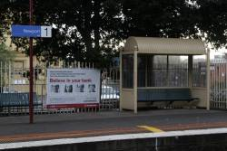 Advertising panels on the platform fence at Newport