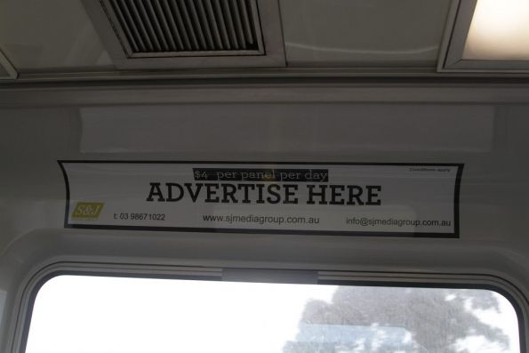 'Advertising here - $4 per panel per day' advertisement inside a Comeng train