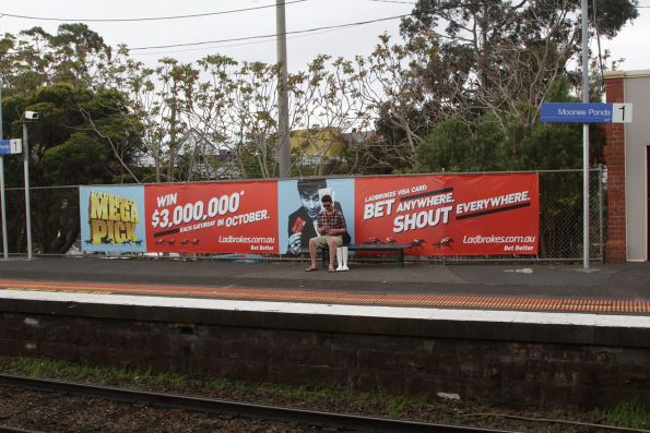 Advertising for Ladbrokes bookmakers covers Moonee Ponds station