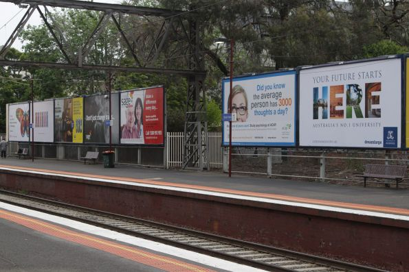 Collection of education related billboards at South Yarra station