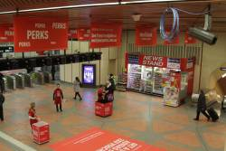 Handing out Medibank Private flyers at an advertising covered Flagstaff station