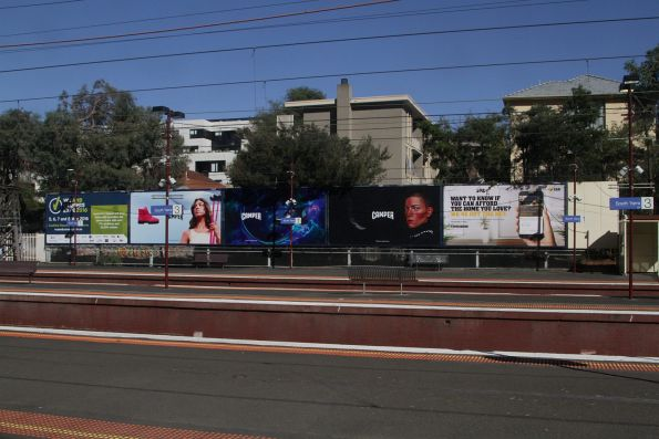 Array of advertising billboards at South Yarra station