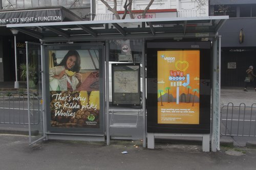 Fantastic tram stop - one seat, two advertising posters