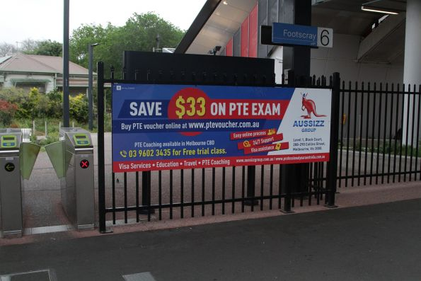 Advert for a PTE English exam provider at Footscray station