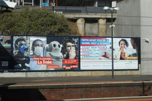 La Trobe University and Australian College of Applied Psychology advertisements at North Melbourne station