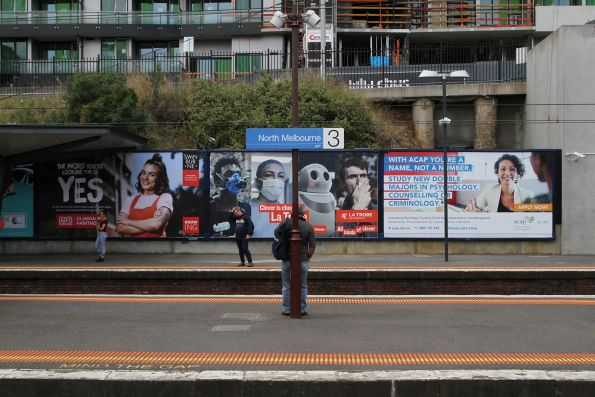 University billboards take over at North Melbourne station