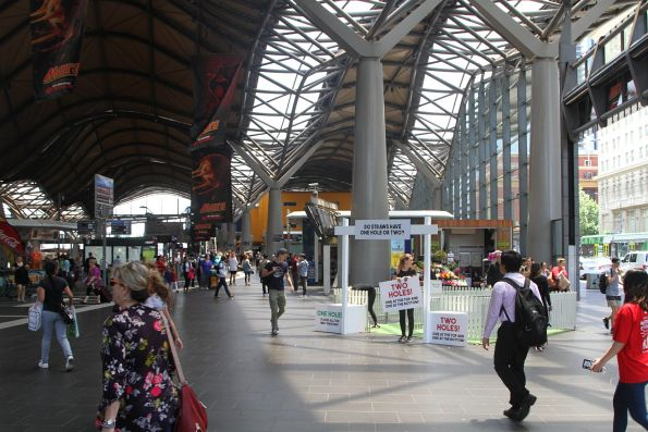 'Do straws have one hole or two' promotion blocking the main entrance at Southern Cross Station