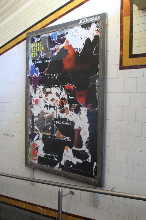 Tattered advertising posters in the Elizabeth Street subway at Flinders Street Station
