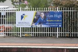 Advertisement for Westall Secondary College at Oakleigh station